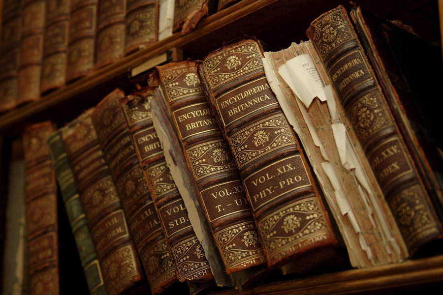 Featured old bound library books, first edition encyclopedias and leather gilded spines