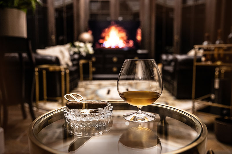 Hermes Estate cozy cigar room and fireplaces call for a beverage and a snuggle.