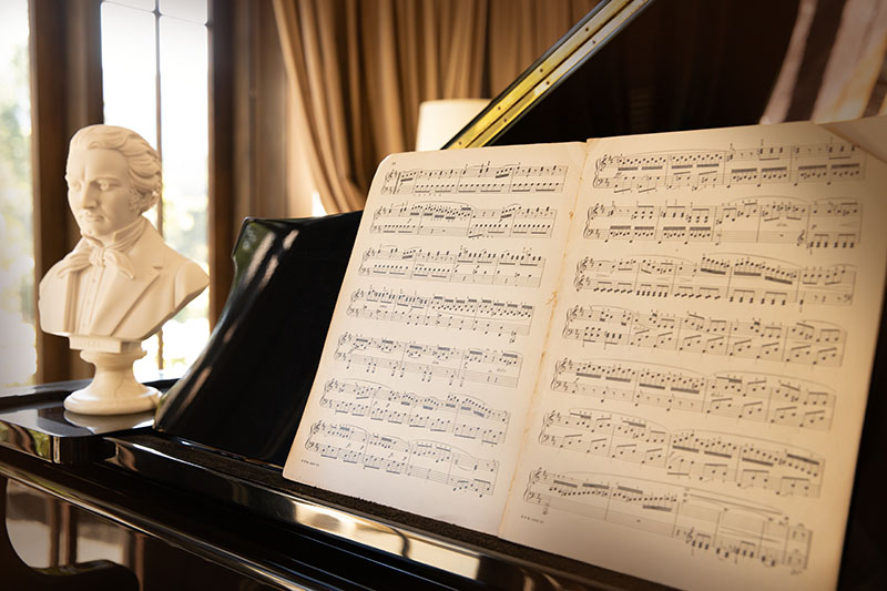 Play the elegant grand piano at Hermes Estate