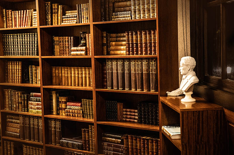 Antique library of vintage and first edition books in the bibliotheque at Hermes Estate